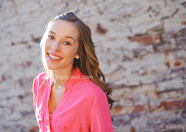 a hot-pink shirt and a beautiful smile for her sacramento senior portraits