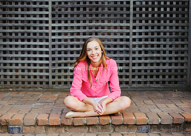 done for the day in her pink blouse and a cool lattice wall behind her in sacramento california