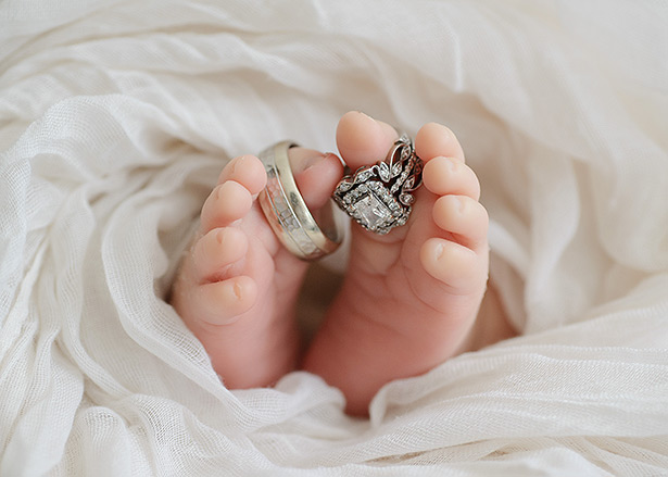 classic newborn picture of rings on toes