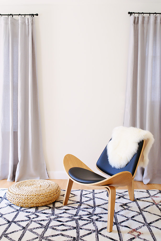 black and wooden chair is a centerpiece in the natural light studio