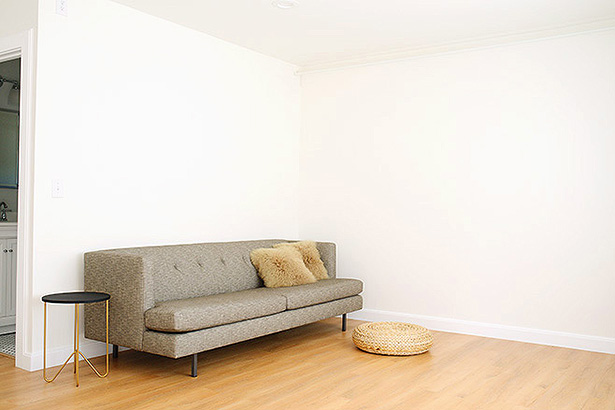 mcm sofa and white walls are a fun backdrop for this studio