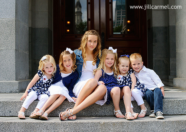 six cousins all together for their child portraits on the capitol stairs