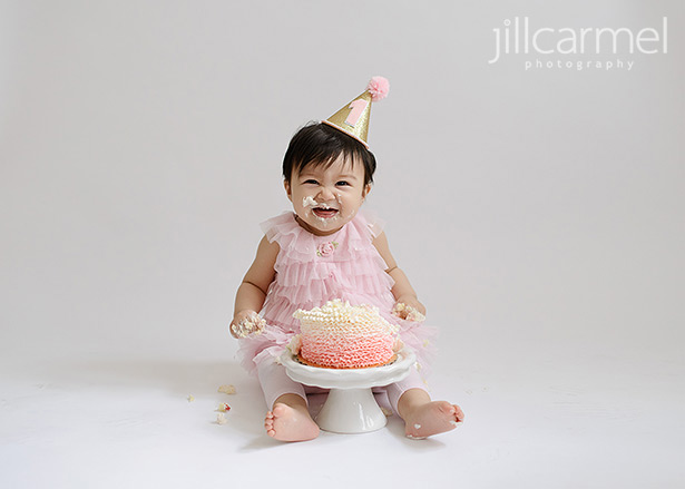 cake all over face in this sacramento studio for cake smash and first birthday