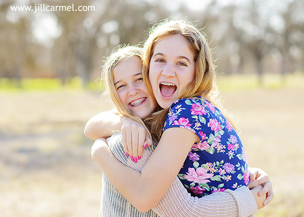best friends hug with natural smiles for this girls portrait session