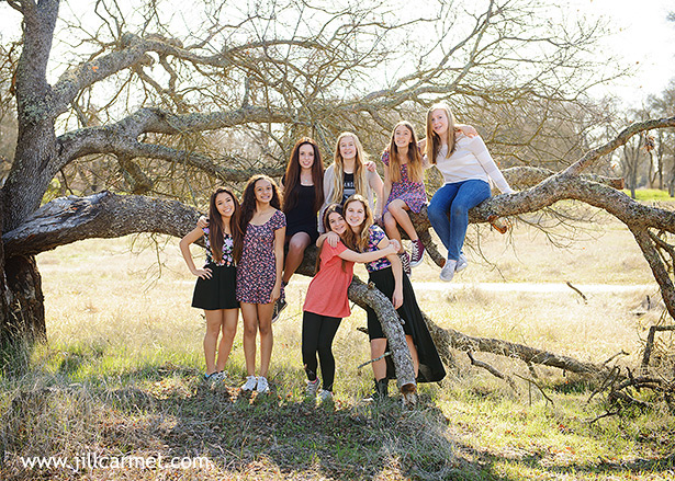 the girls climbed a tree for their birthday group picture