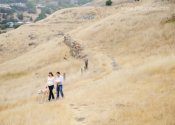 mom dad and baby walking in the long dry grass down the tiburon slope