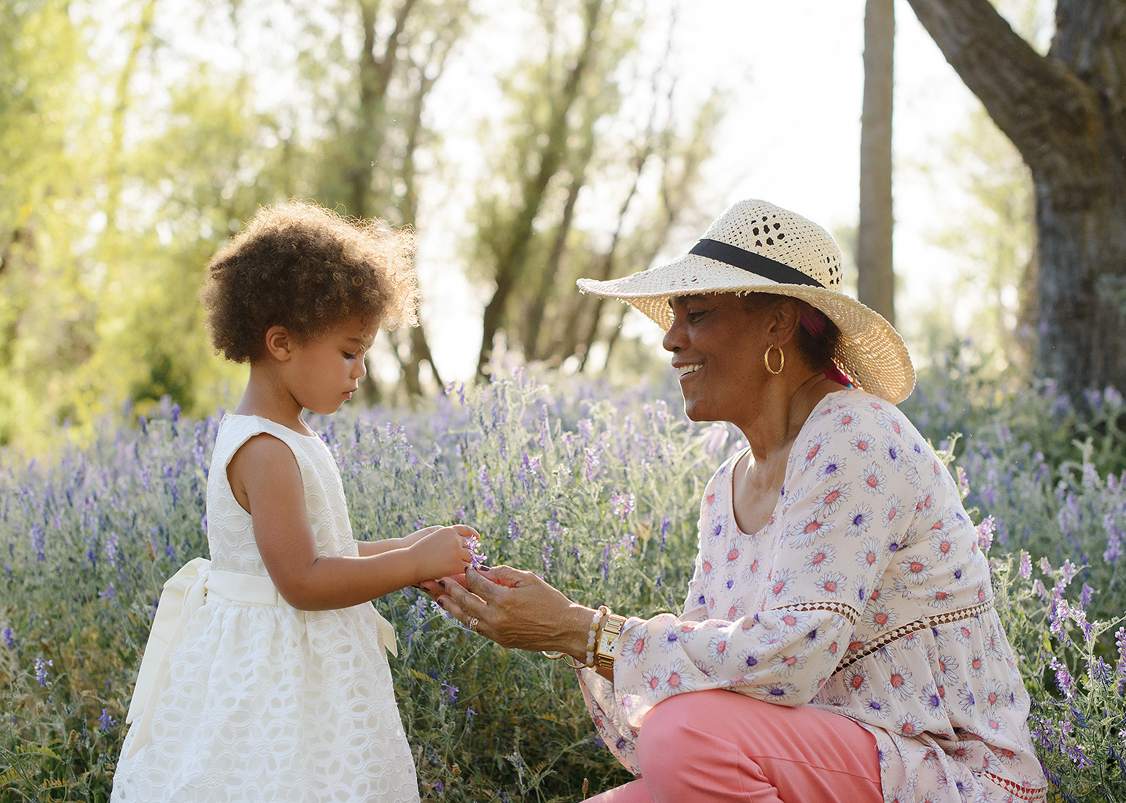 granddaughter and grandmother picking wildflowers