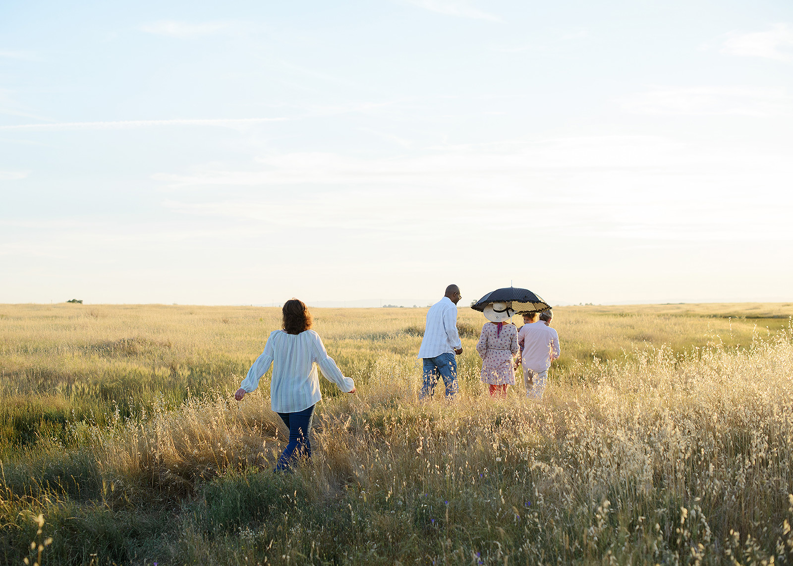 family walking through a field of wildflowers