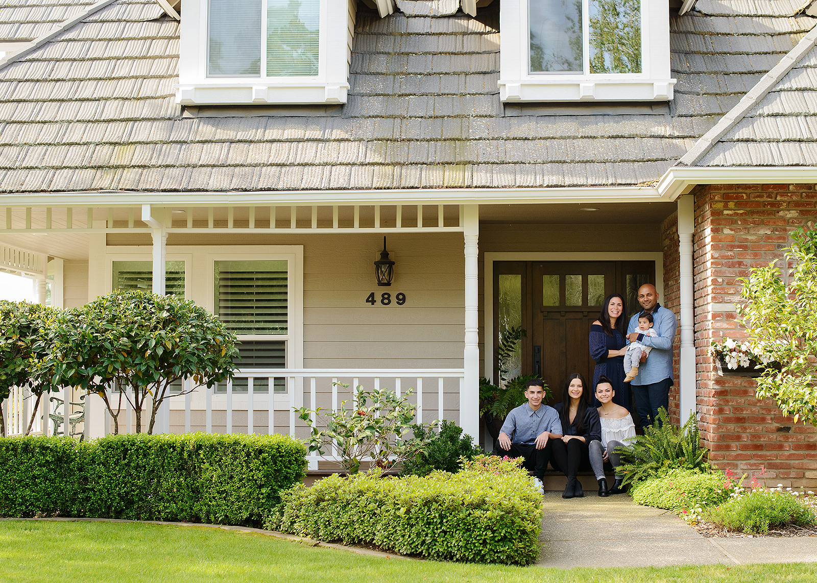 Family photos in front of their new craftsman home in el dorado hills