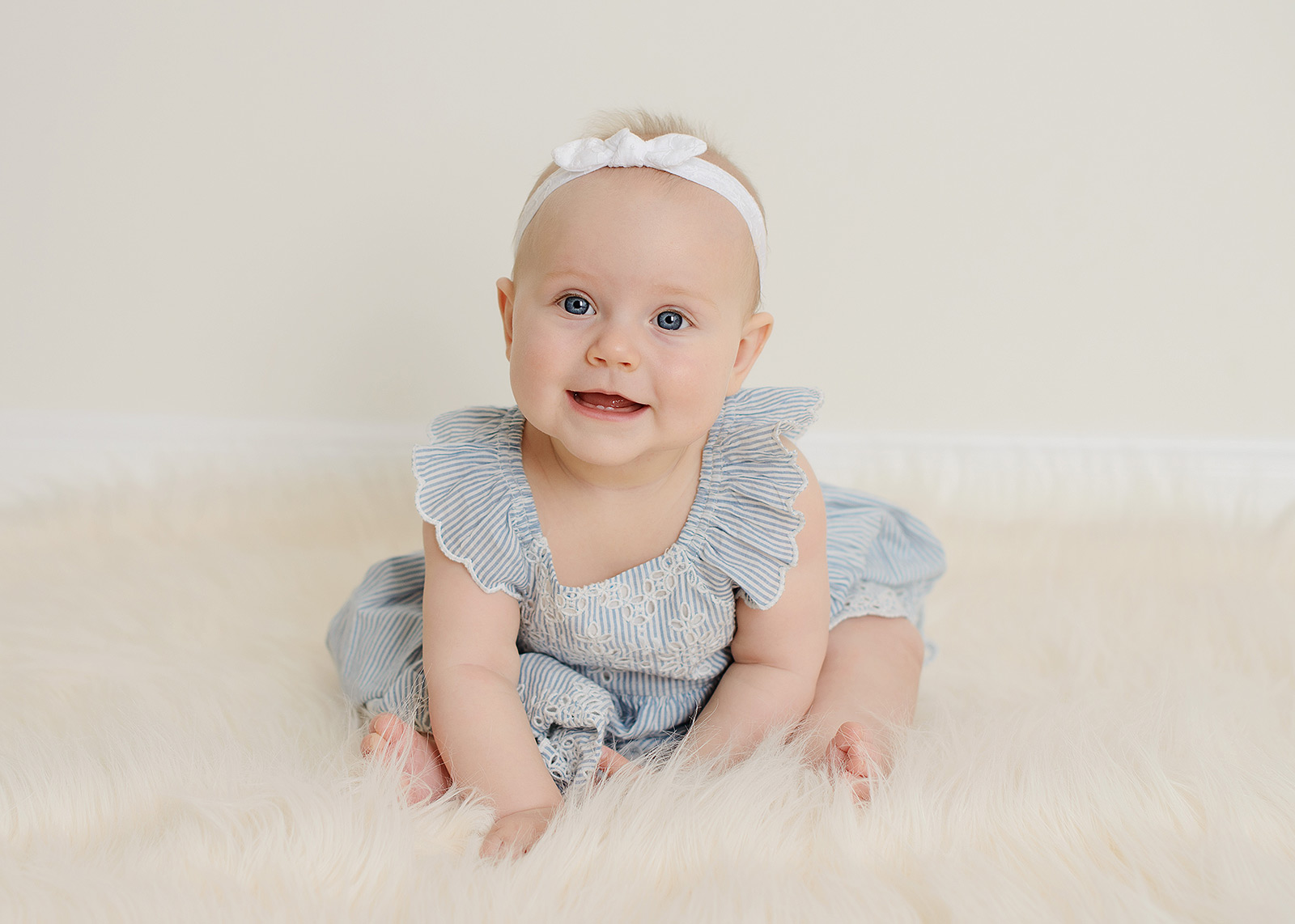Baby Girl with Blue Eyes Sitting Up in Sacramento Studio