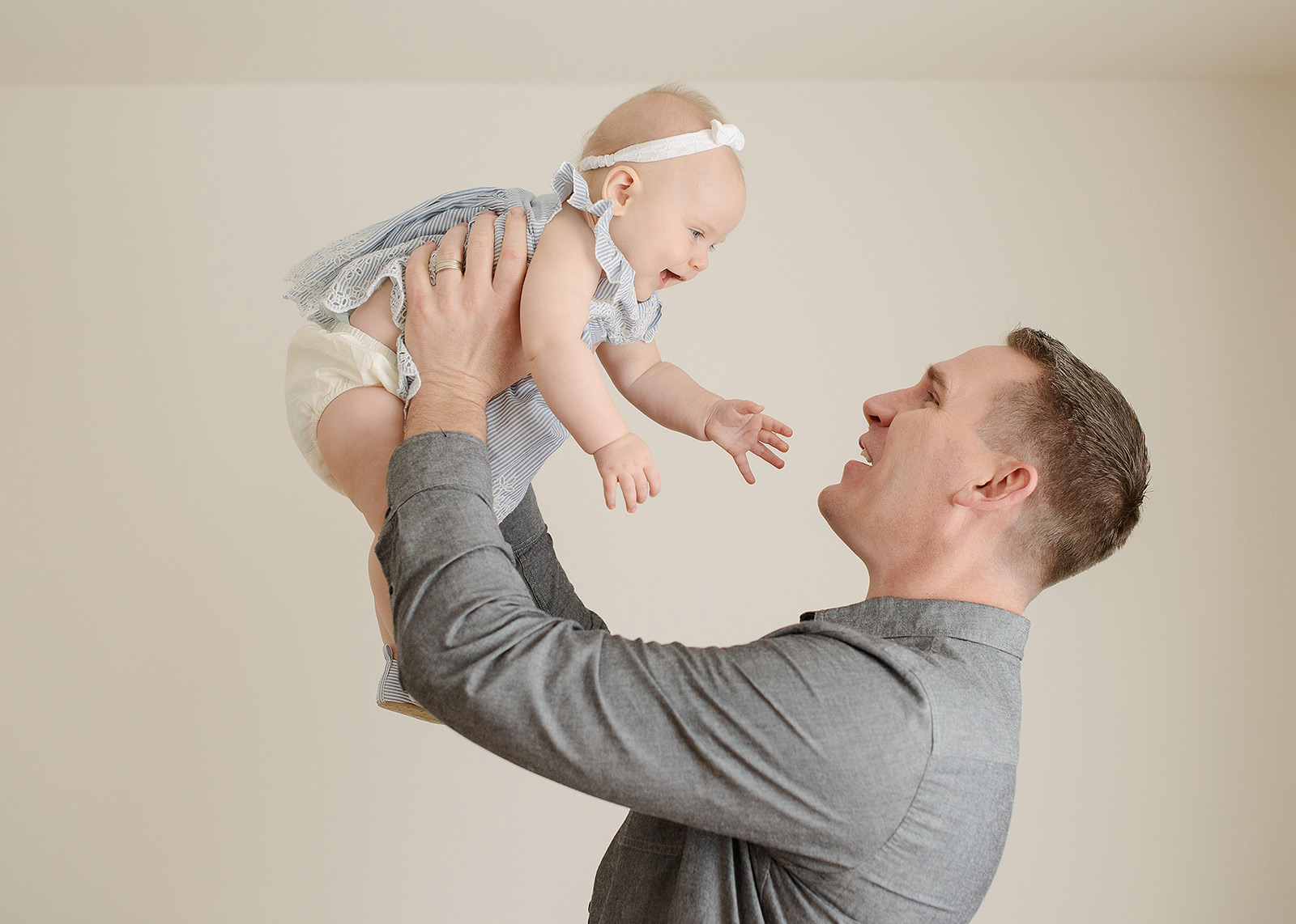 Dad Holds Baby Daughter in Air for Sacramento Photography Session