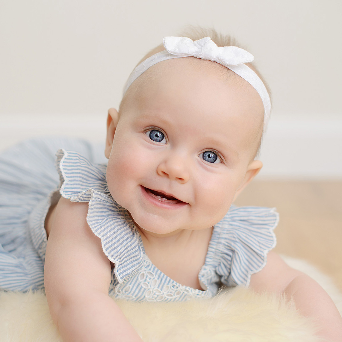 Baby Girl with Blue Eyes Studio Portrait