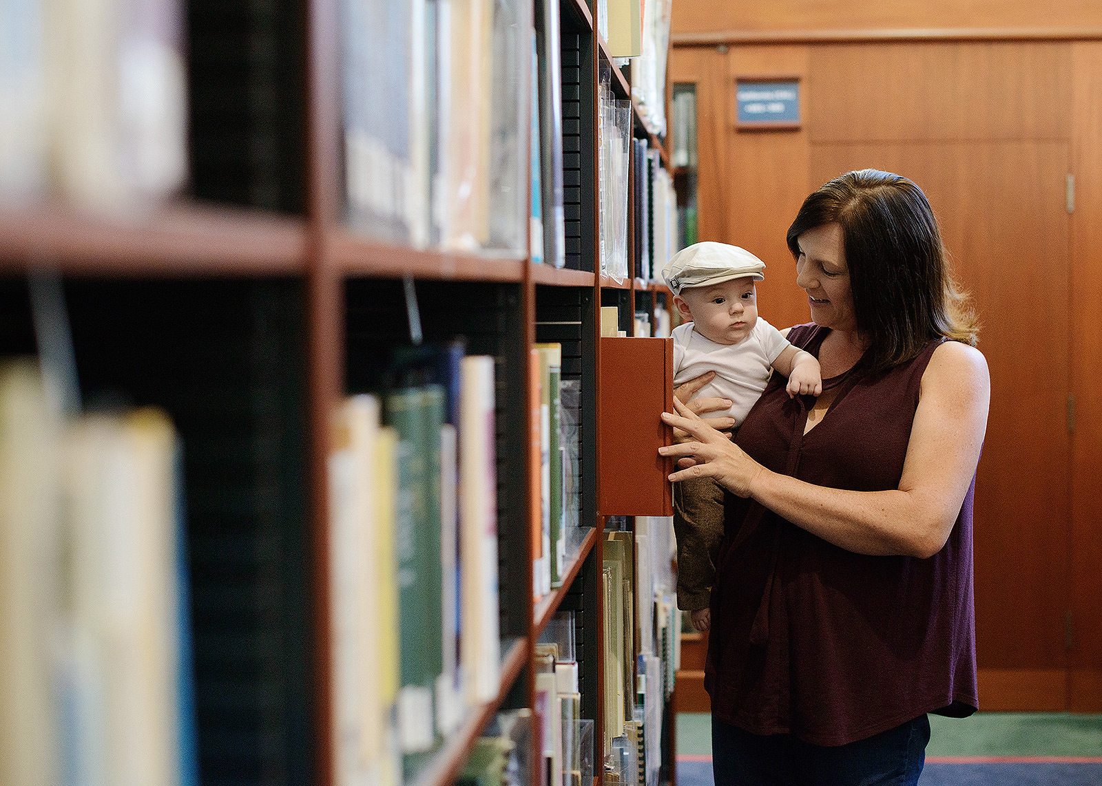 Mom and Baby Son in Library Book Stacks