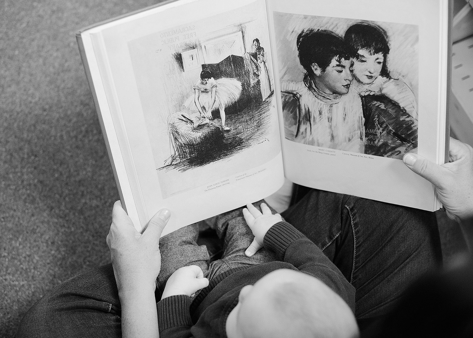 Mother Showing Baby Art Book in Downtown Central Library
