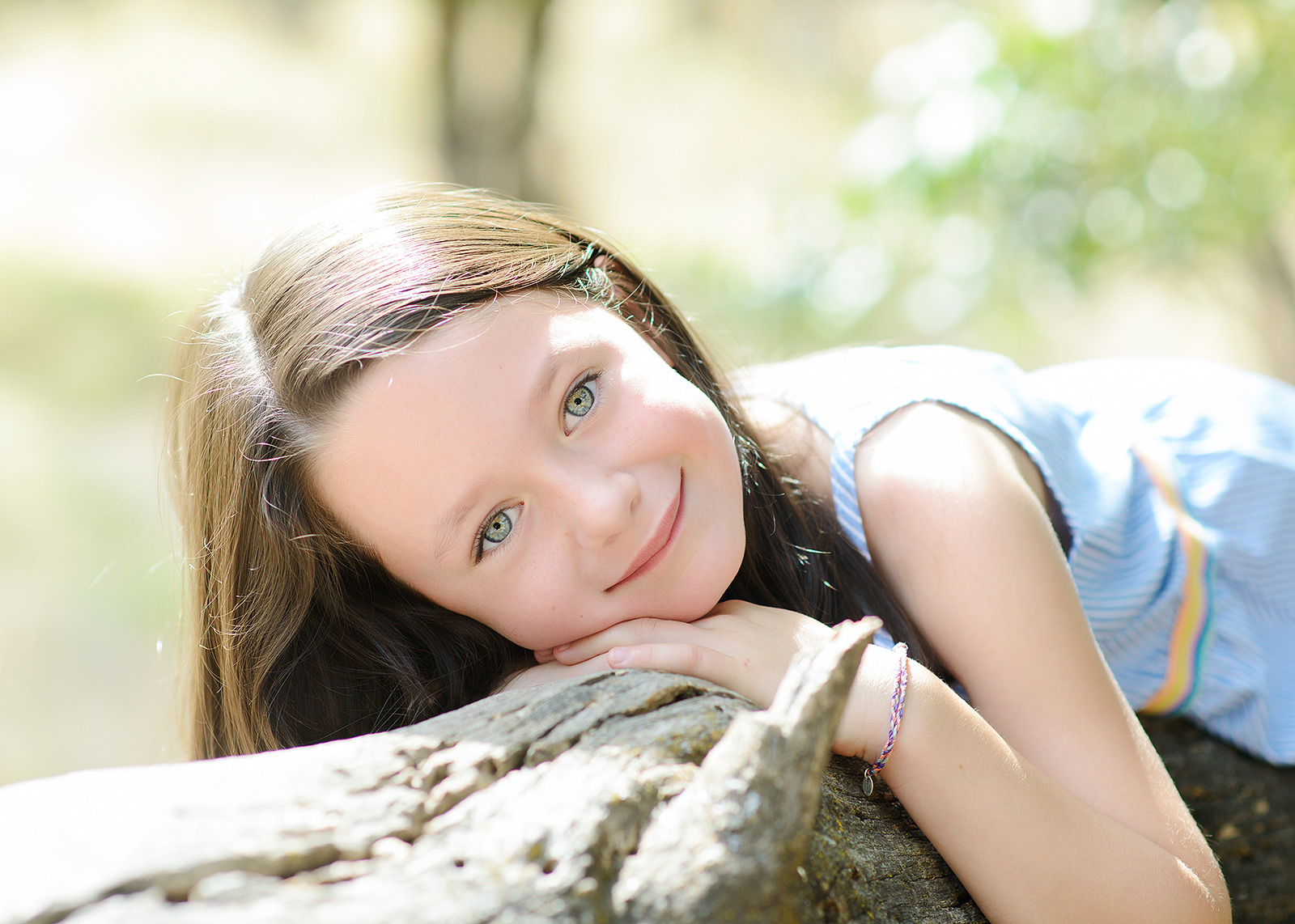 Daughter Smiling with Green Eyes on Fallen Log at Effie Yeaw Nature Center