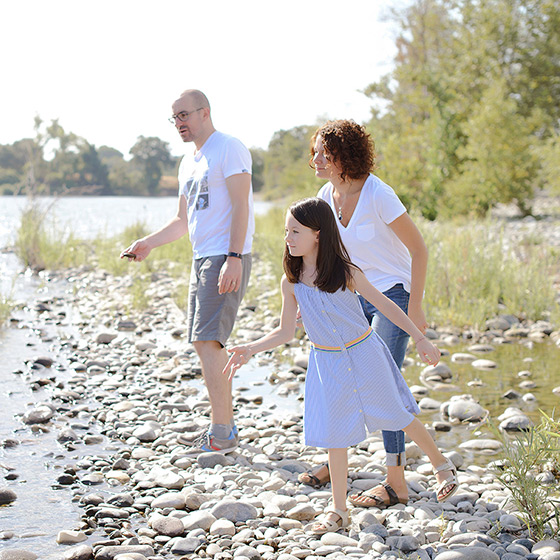 Family Skipping Rocks at Effie Yeaw Nature Center