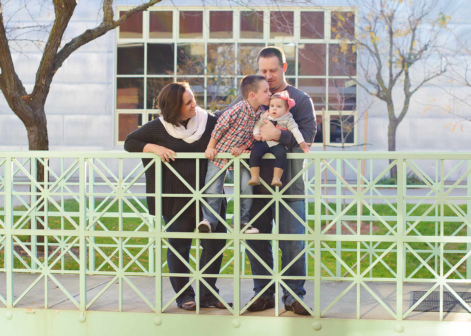 Family Photos on Colorful Modern Green Rail in front of Industrial Building Rocklin Photographer