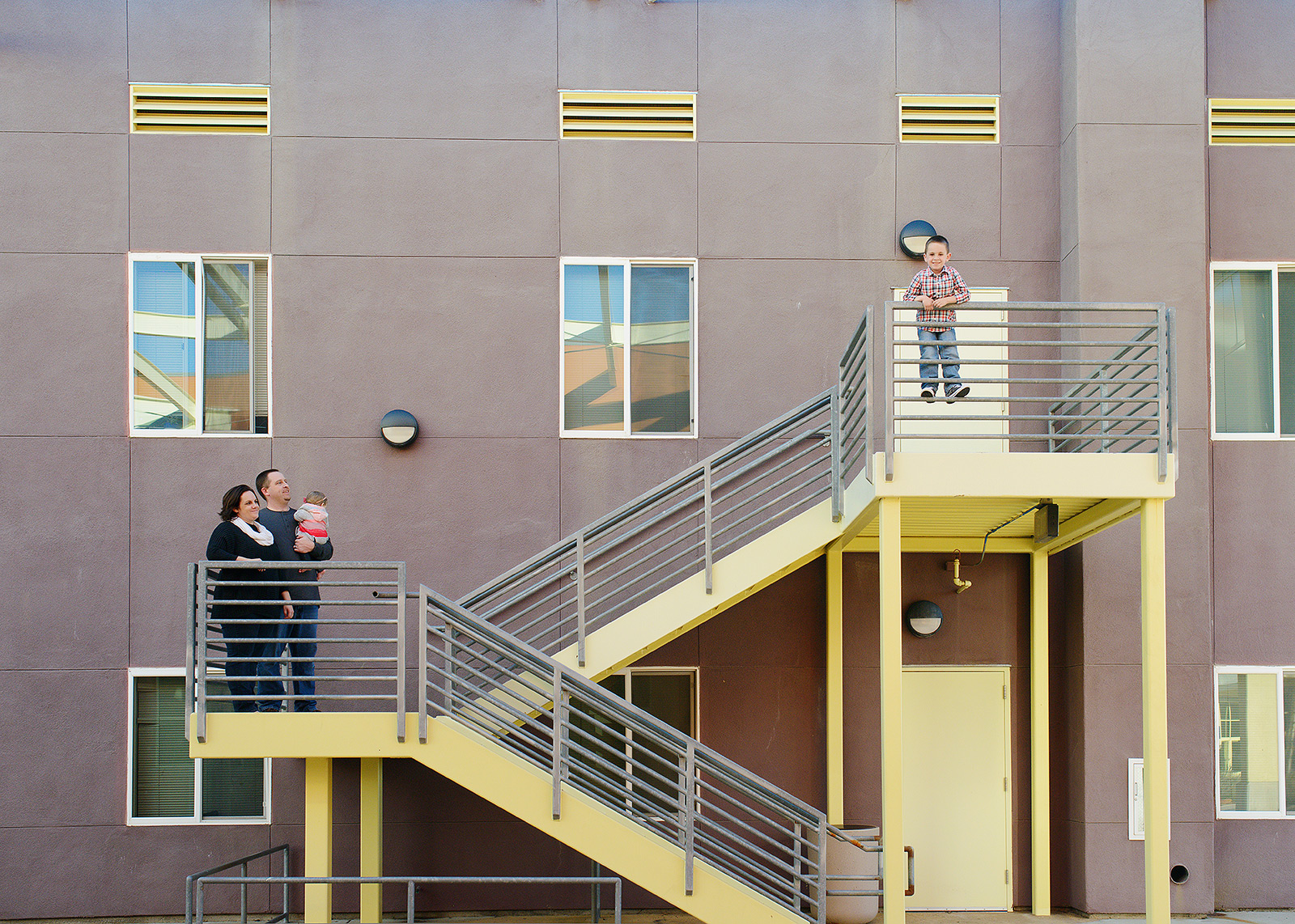 Modern Family Photo on Stairway in Modern Industrial Building for this Sacramento Photographer
