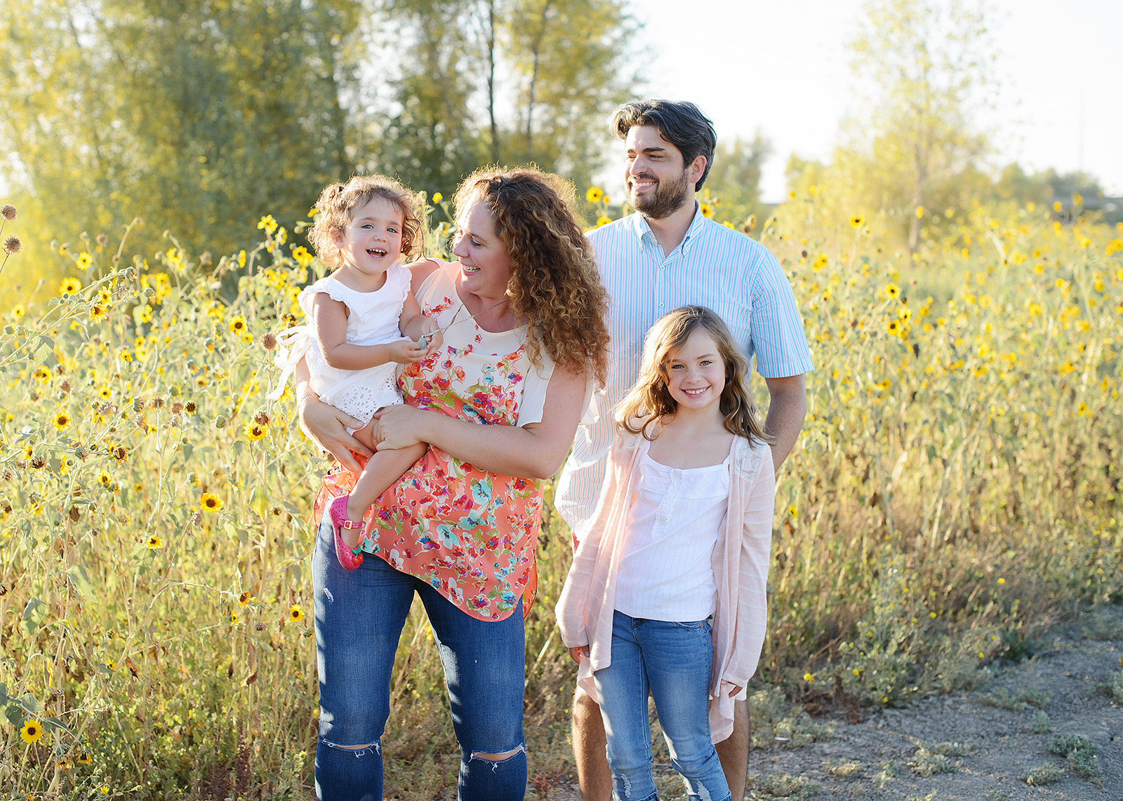 Family Photo Against Yellow Wildflowers in West Sacramento
