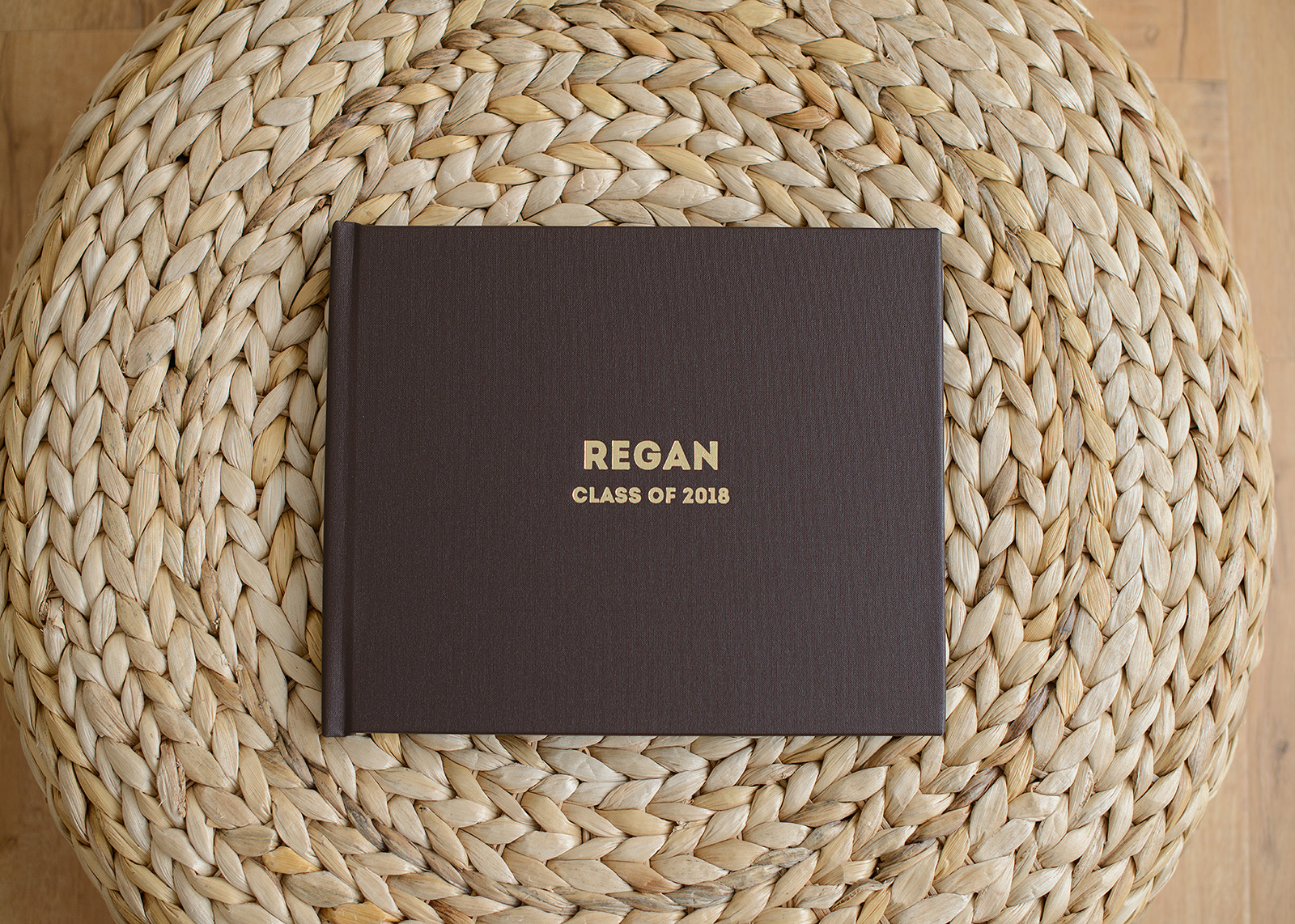 Brown Album Cover Details on Tan Woven Background