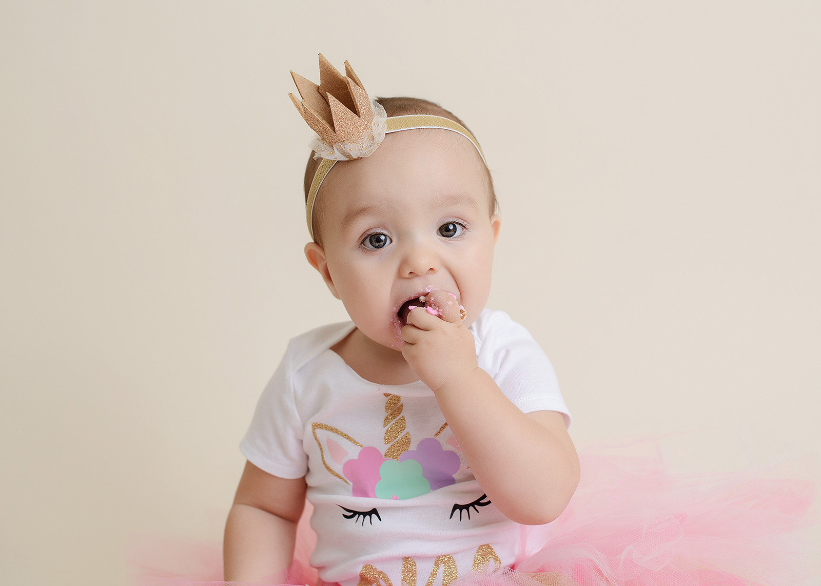 Baby Girl Eating Pink Frosting in Pink Unicorn Tutu Outfit