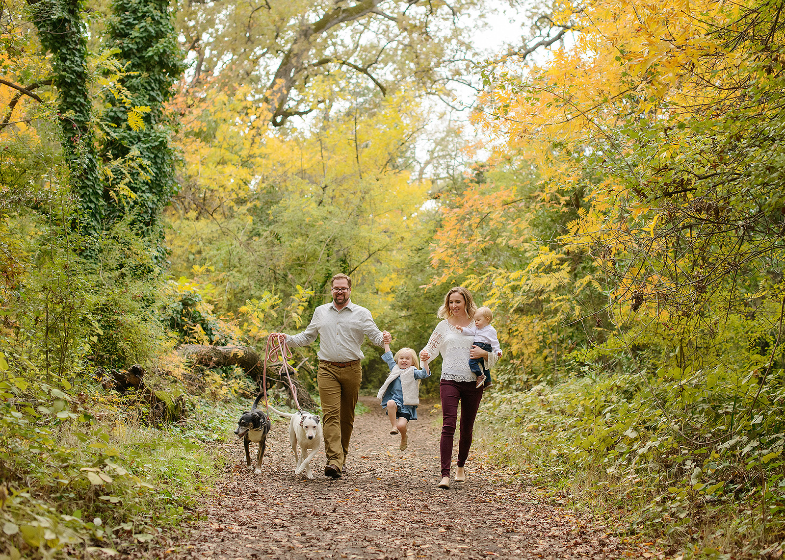 Family Portrait in Chico with Dogs in Tree Foliage Background