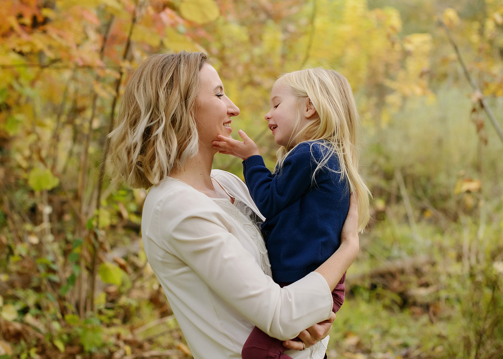 Mom and Daughter Loving Gaze with Tree Background