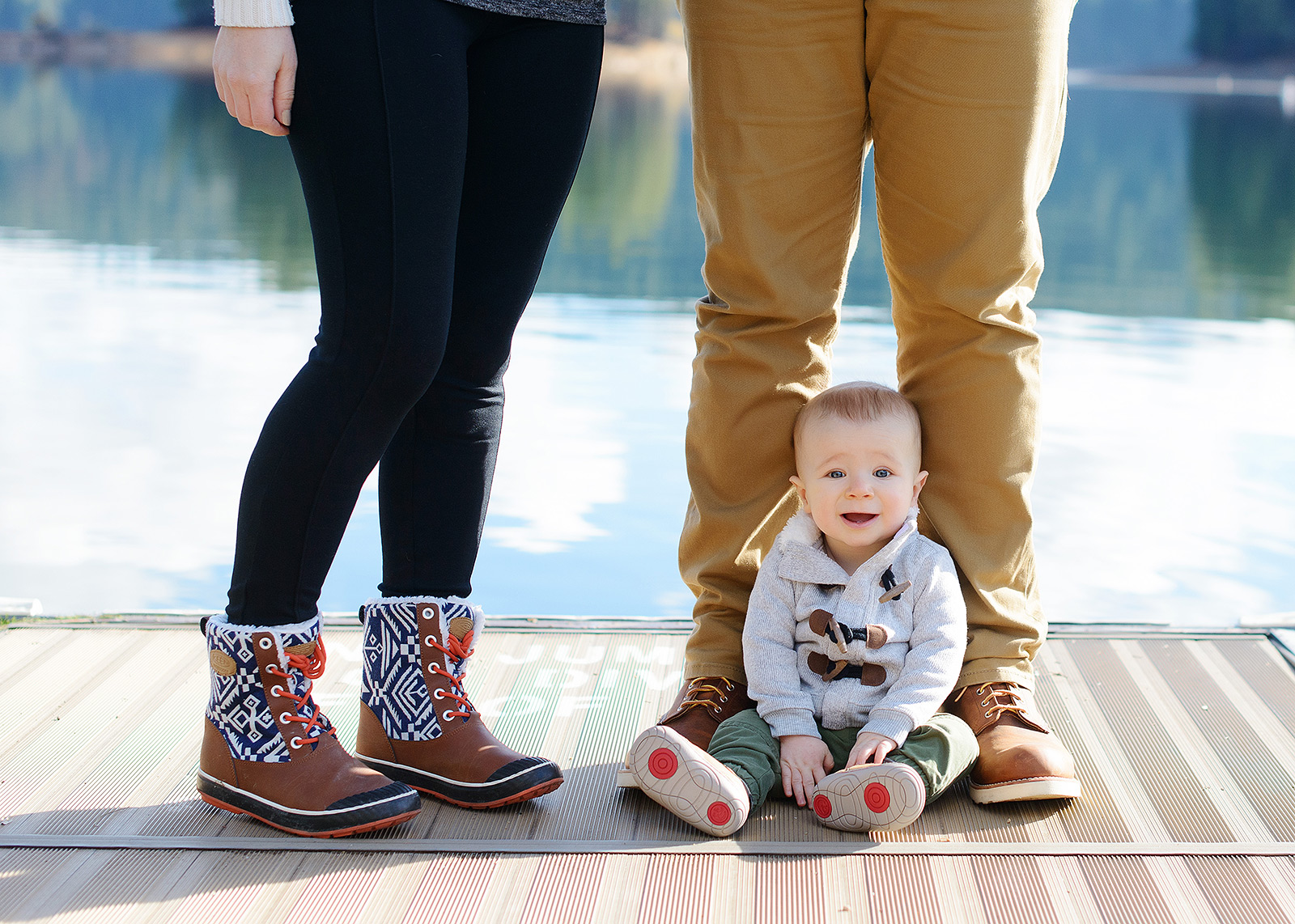 Baby Boy Wearing Boots by Parents Feet by Pollock Pines Lake
