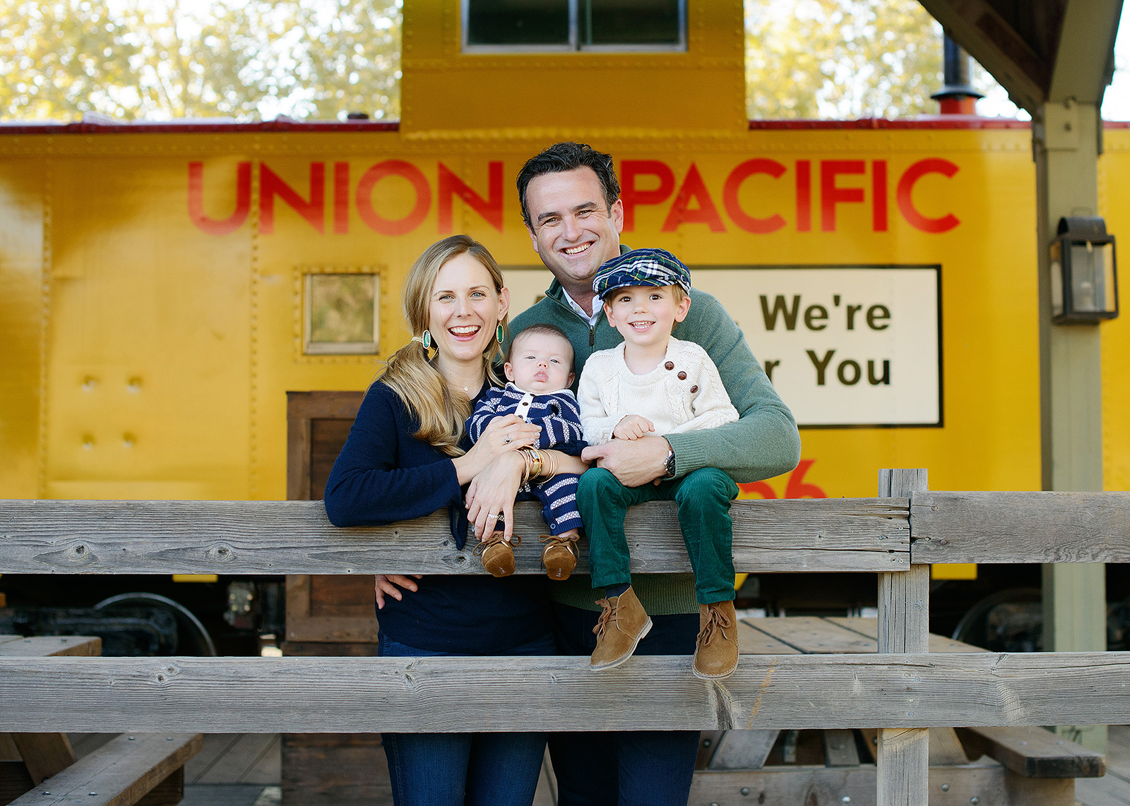 Family Posing in Front of Yellow Union Pacific Train in Old Sacramento