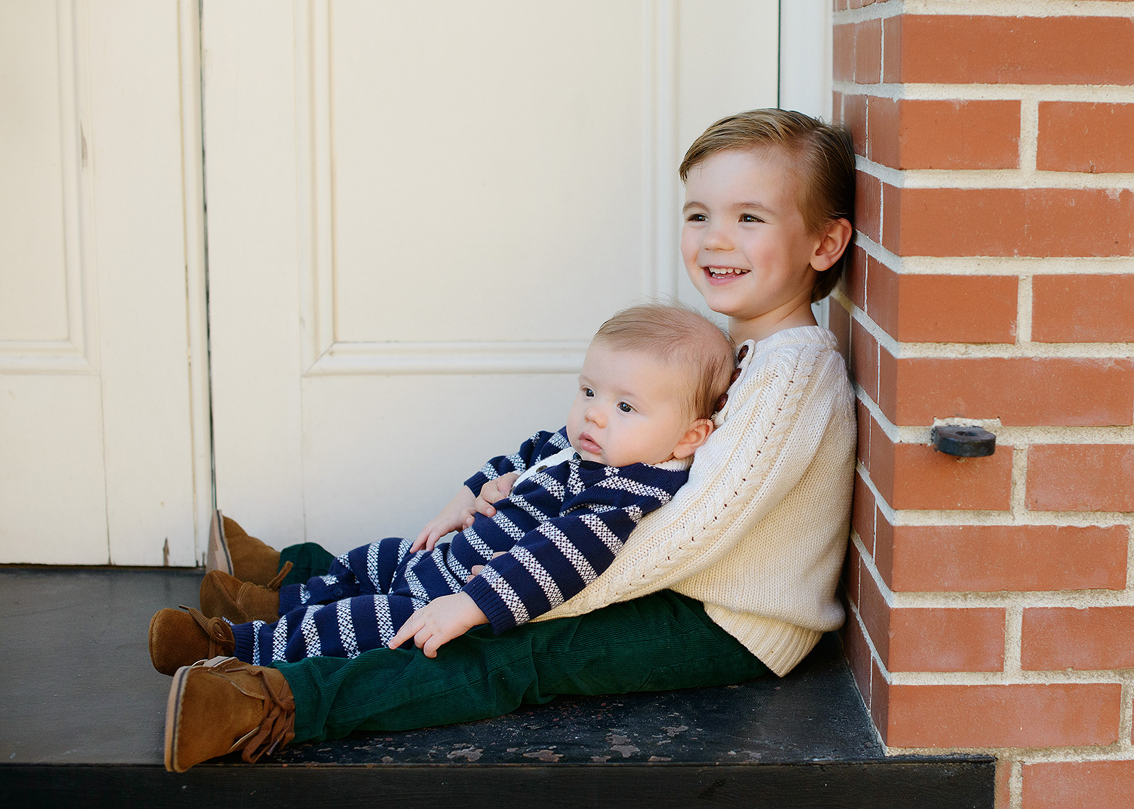 Brothers Posing in Front of White Door and Brick Building in Old Sacramento