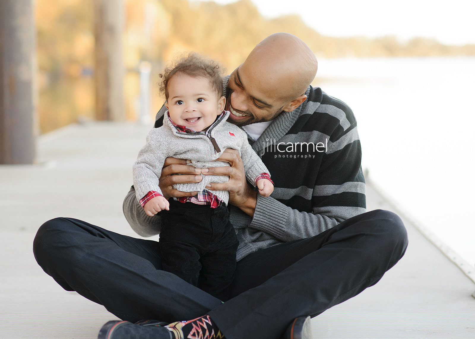 Vince Carter with Baby Boy Sitting at the Dock