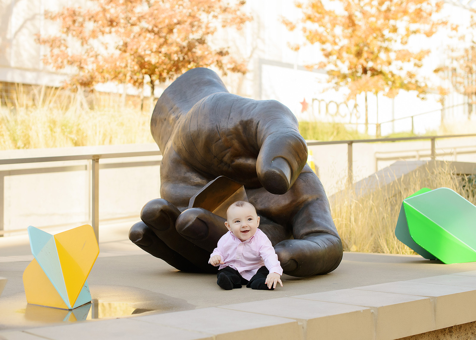 Baby Boy Laughing by Gale Hart Hand Sculpture at Golden 1 Center
