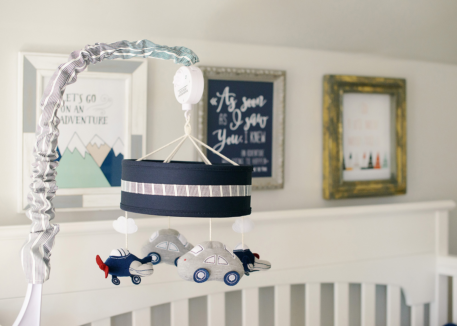 Blue and gray planes and cars baby mobile over crib