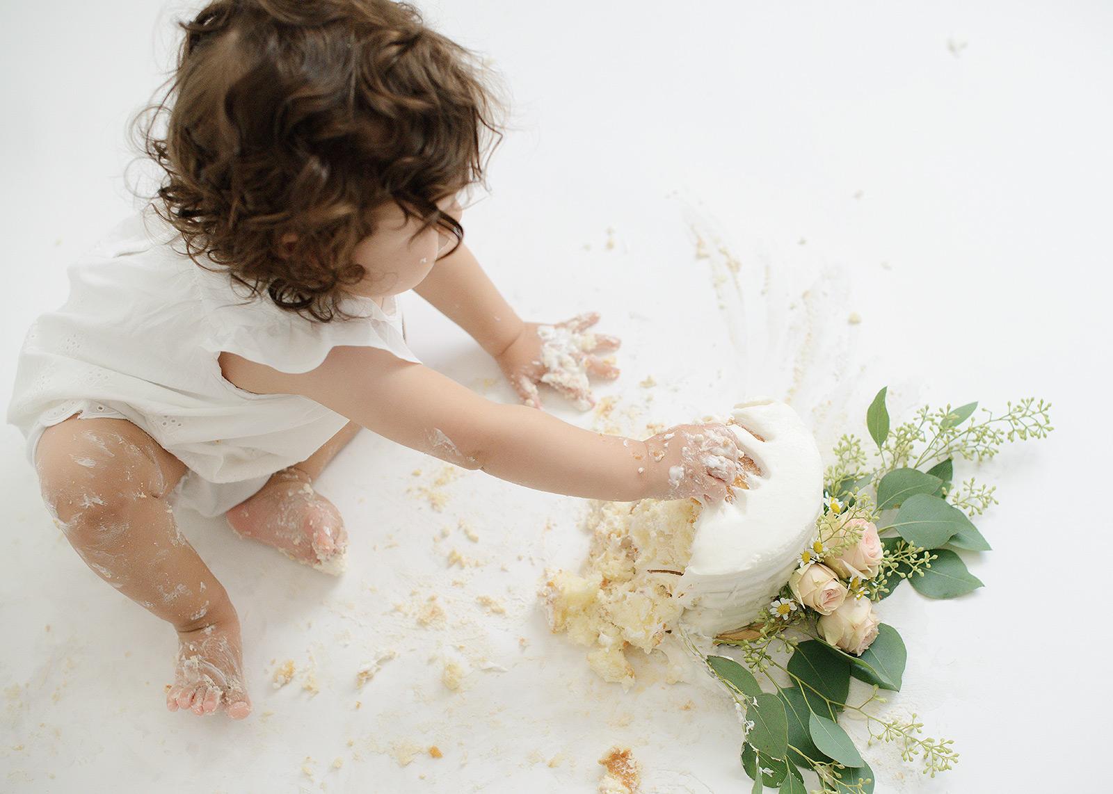 Baby Girl with Curl Hair Smashing Cake