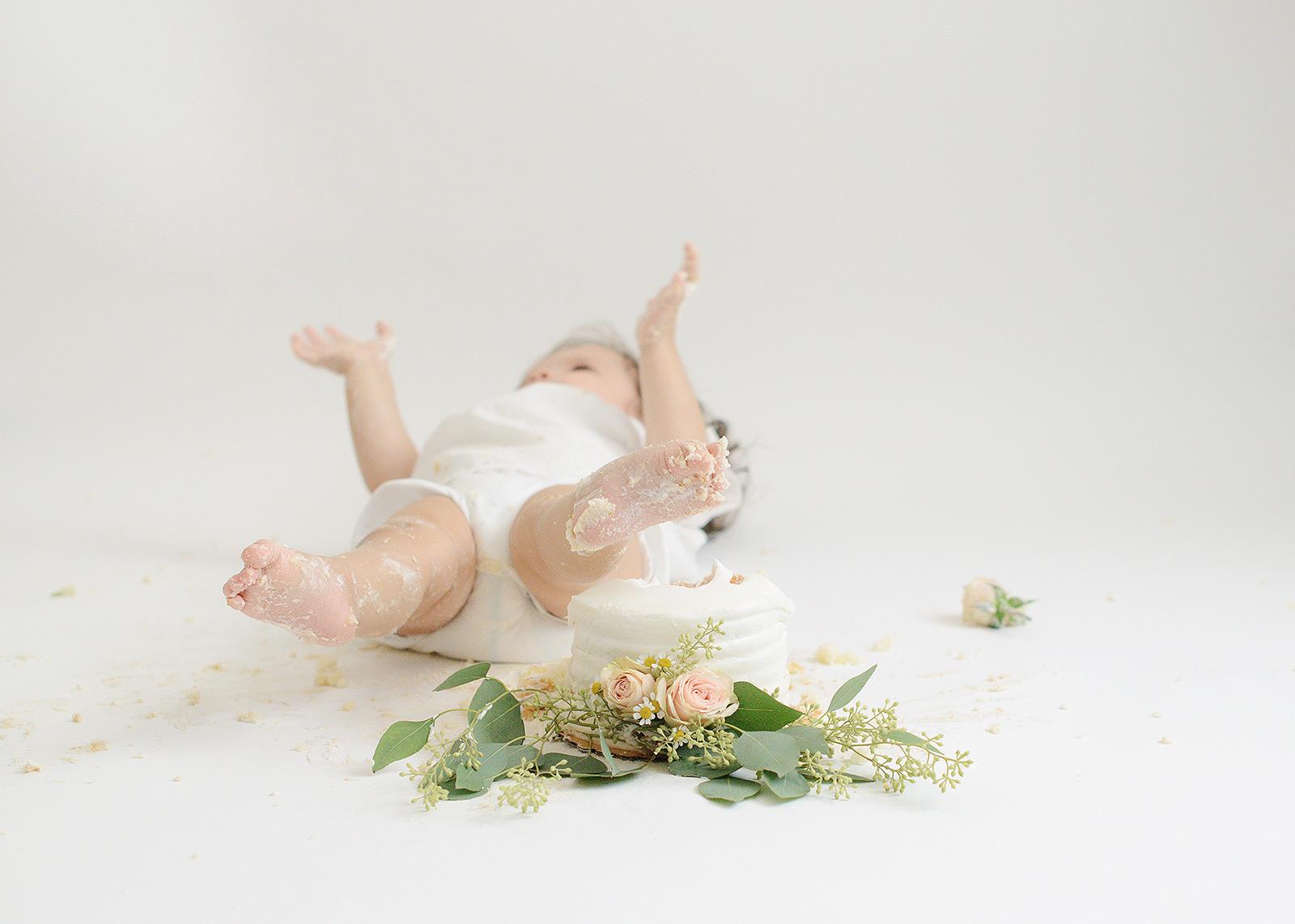 Baby Girl Lying on Floor After Cake Smash