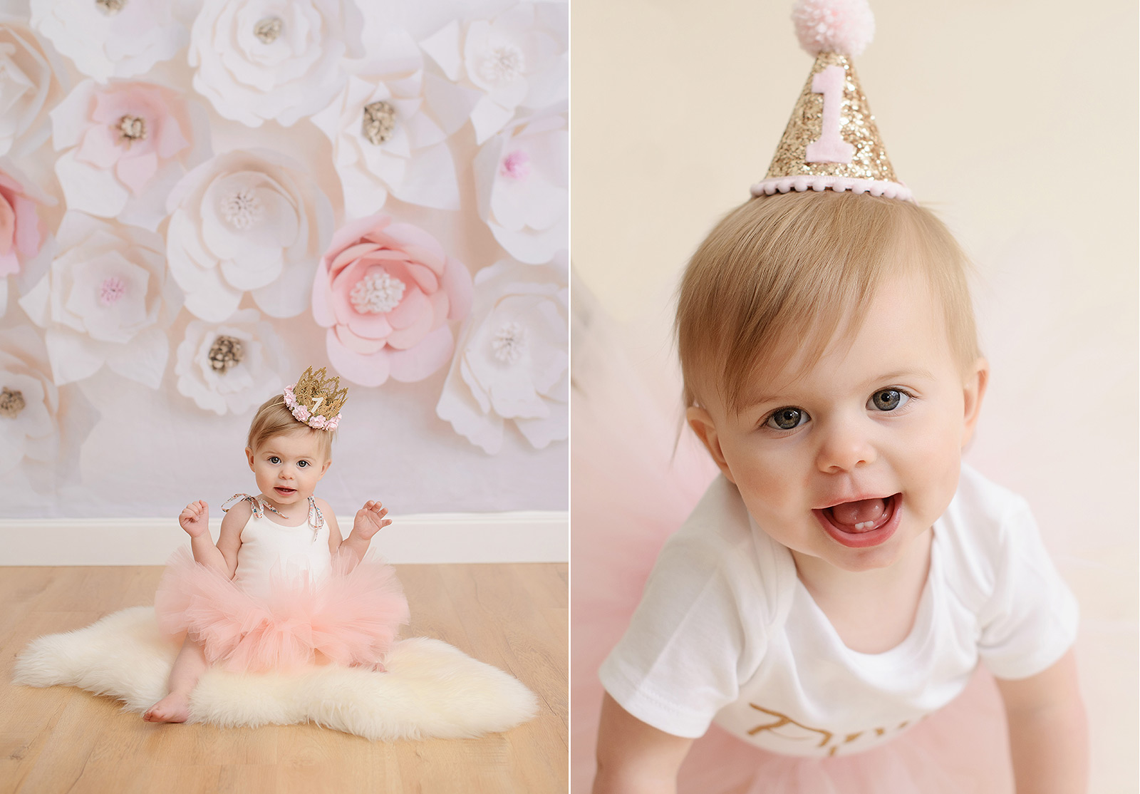 One year old baby girl in pink tutu smiling against paper flowers
