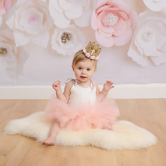 One Year Old Wearing Pink Tutu and Crown