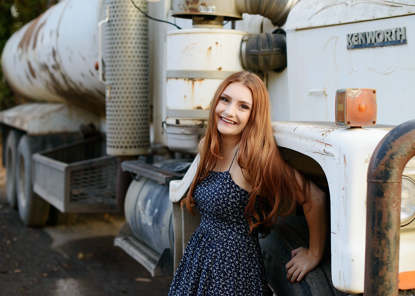 Senior High School Girl Next to White Truck Rig in Sacramento