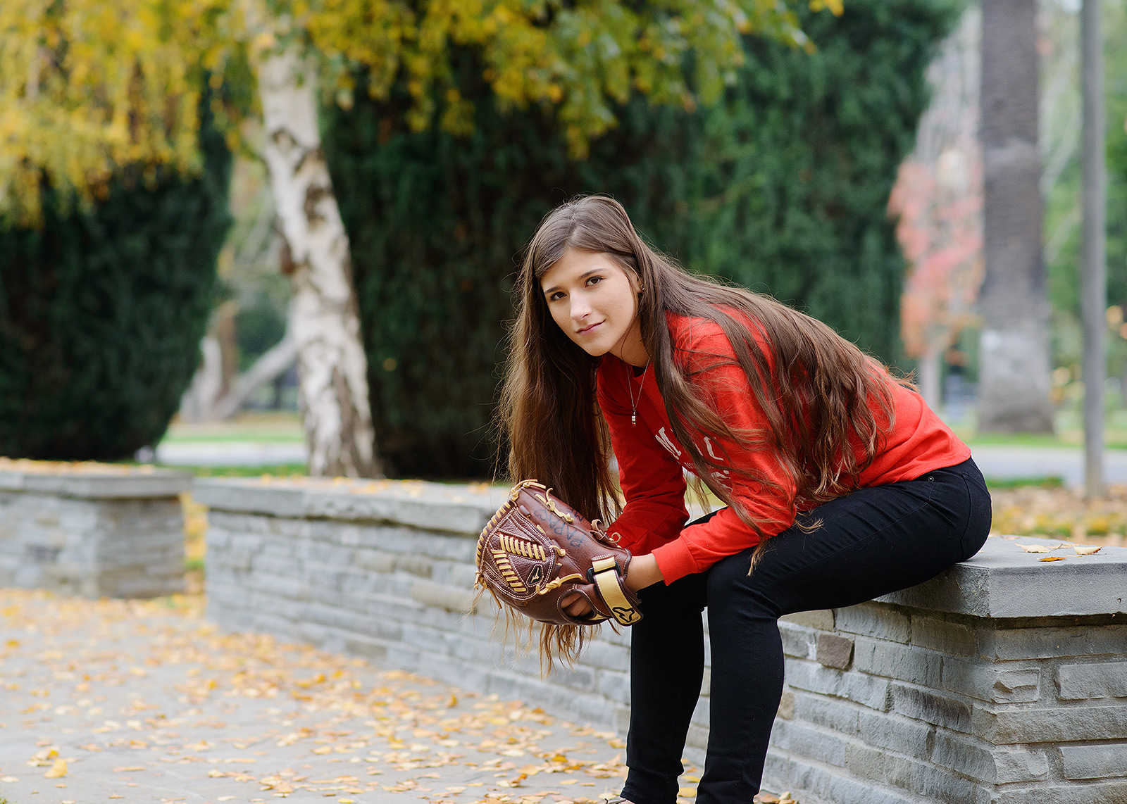Senior softball player portrait with mitt in Sacramento