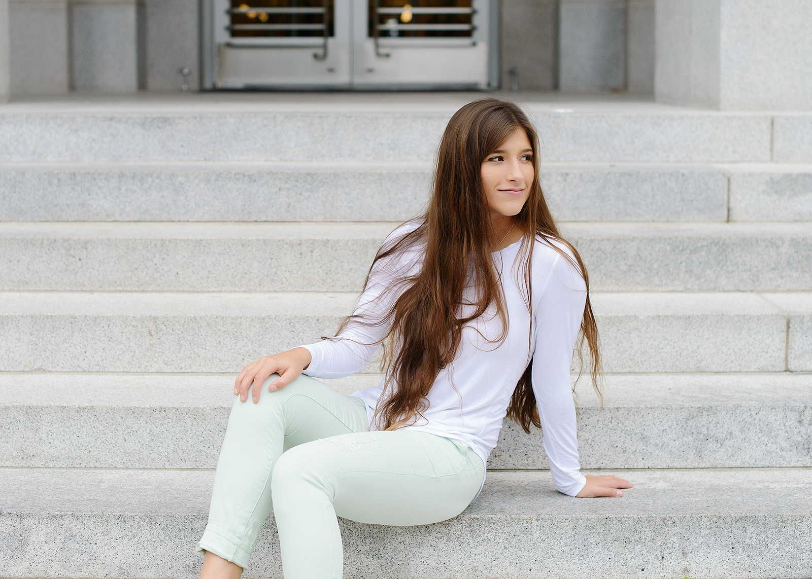 Senior portraits in front of steps in Sacramento State Capitol