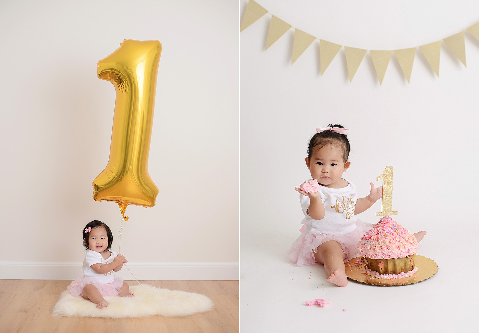Baby girl holding a balloon and eating pink cake smash