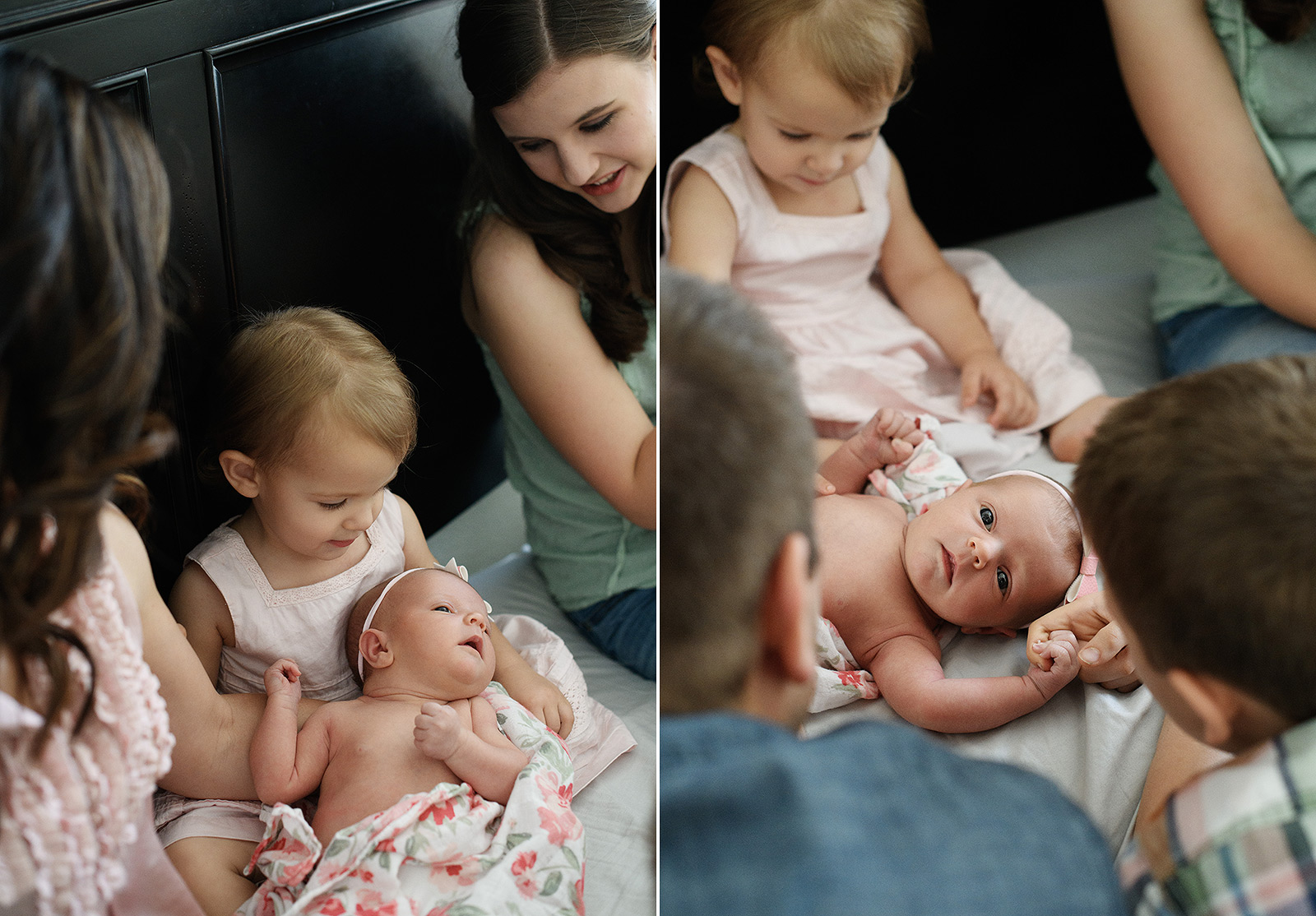 Big sister lovingly holds and gazes at new baby sister on bed lifestyle photo