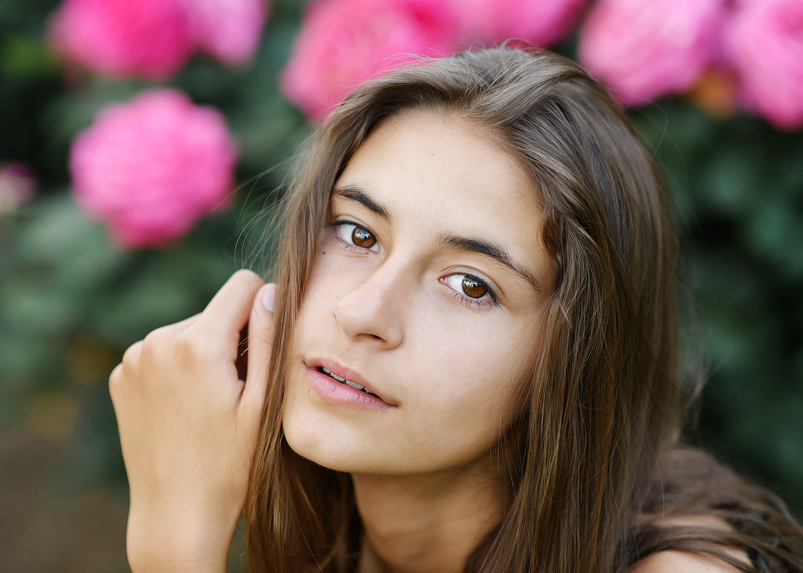 Senior portrait of girl close up with pink flowers in State Capitol