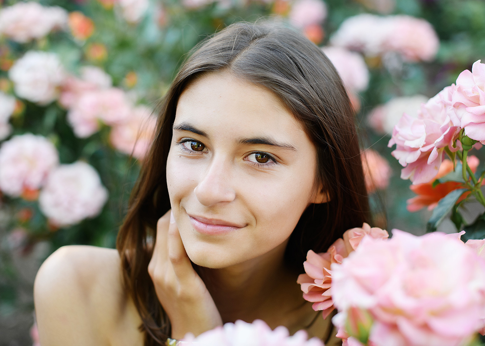 Senior portrait of teen girl in the middle of pink flowers in State Capitol