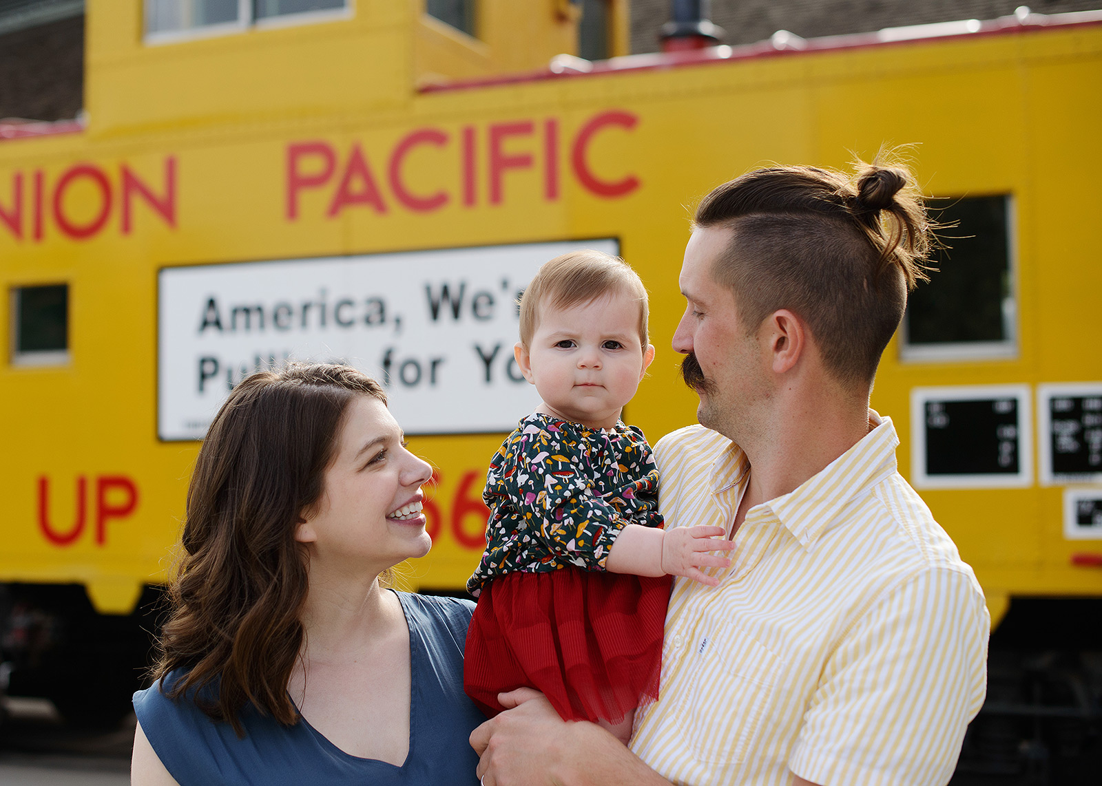 Family photo in front of Union Pacific trains in Old Sacramento