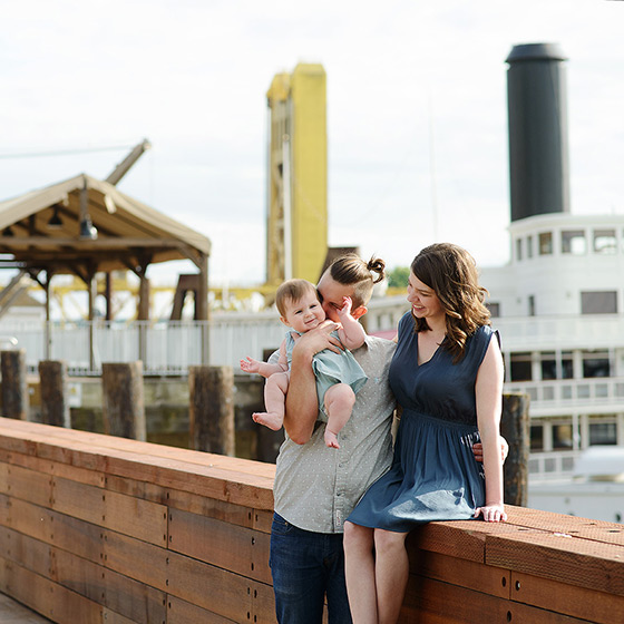 Family photo in Old Sacramento with Tower Bridge in background