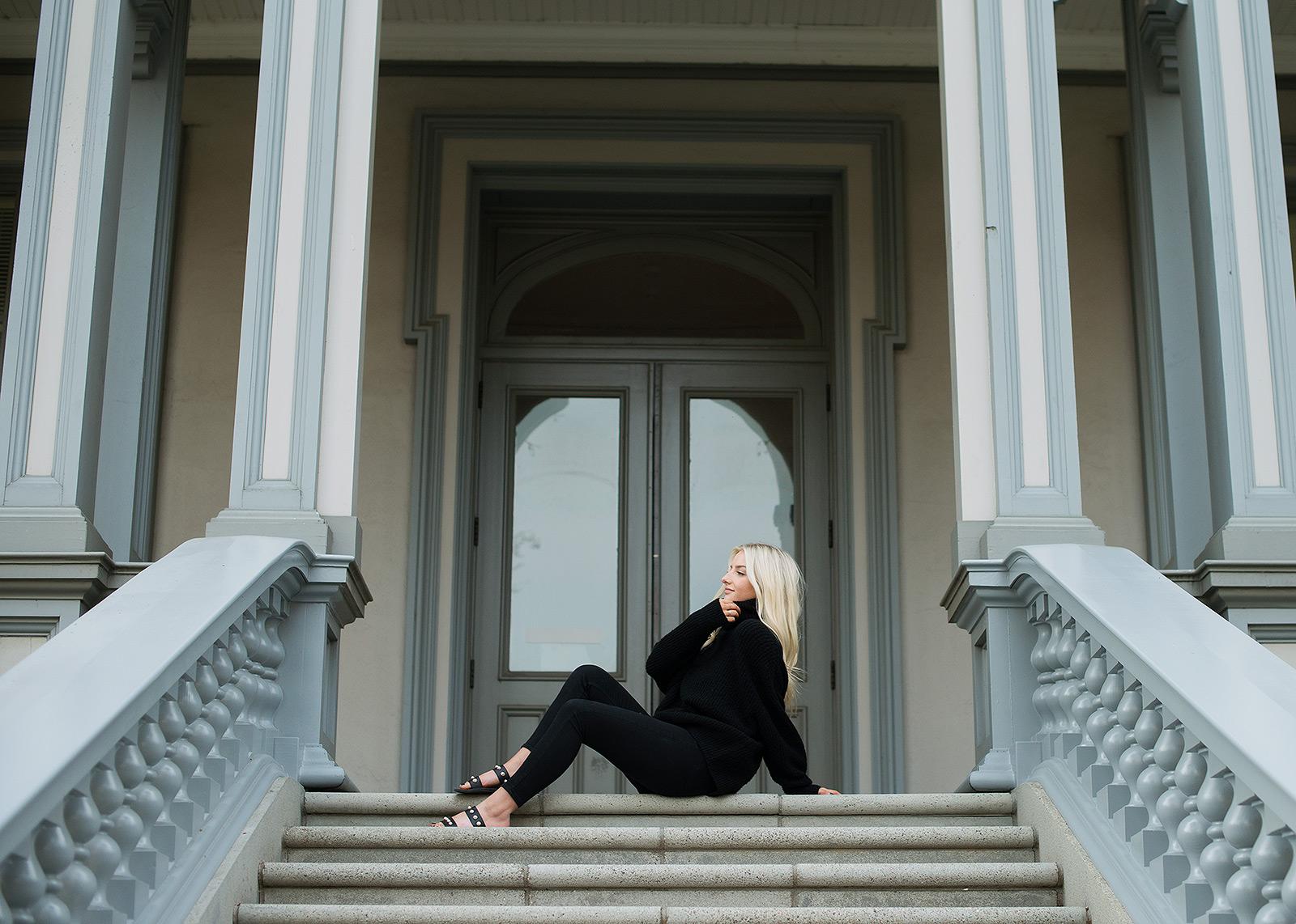 Senior portrait of teen girl sitting down on State Capitol steps