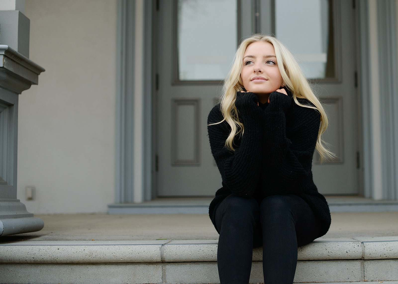 Senior portrait of teen girl wearing black turtleneck on State Capitol steps