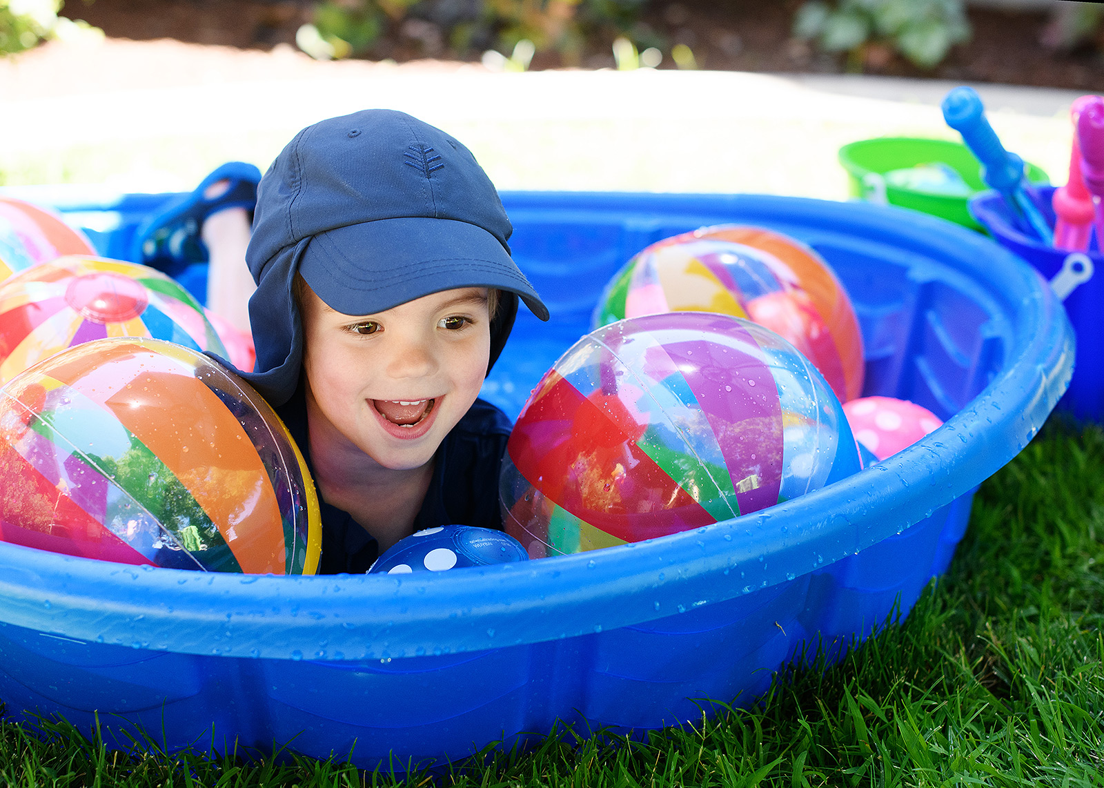 Boy in ball pit enjoying first birthday party