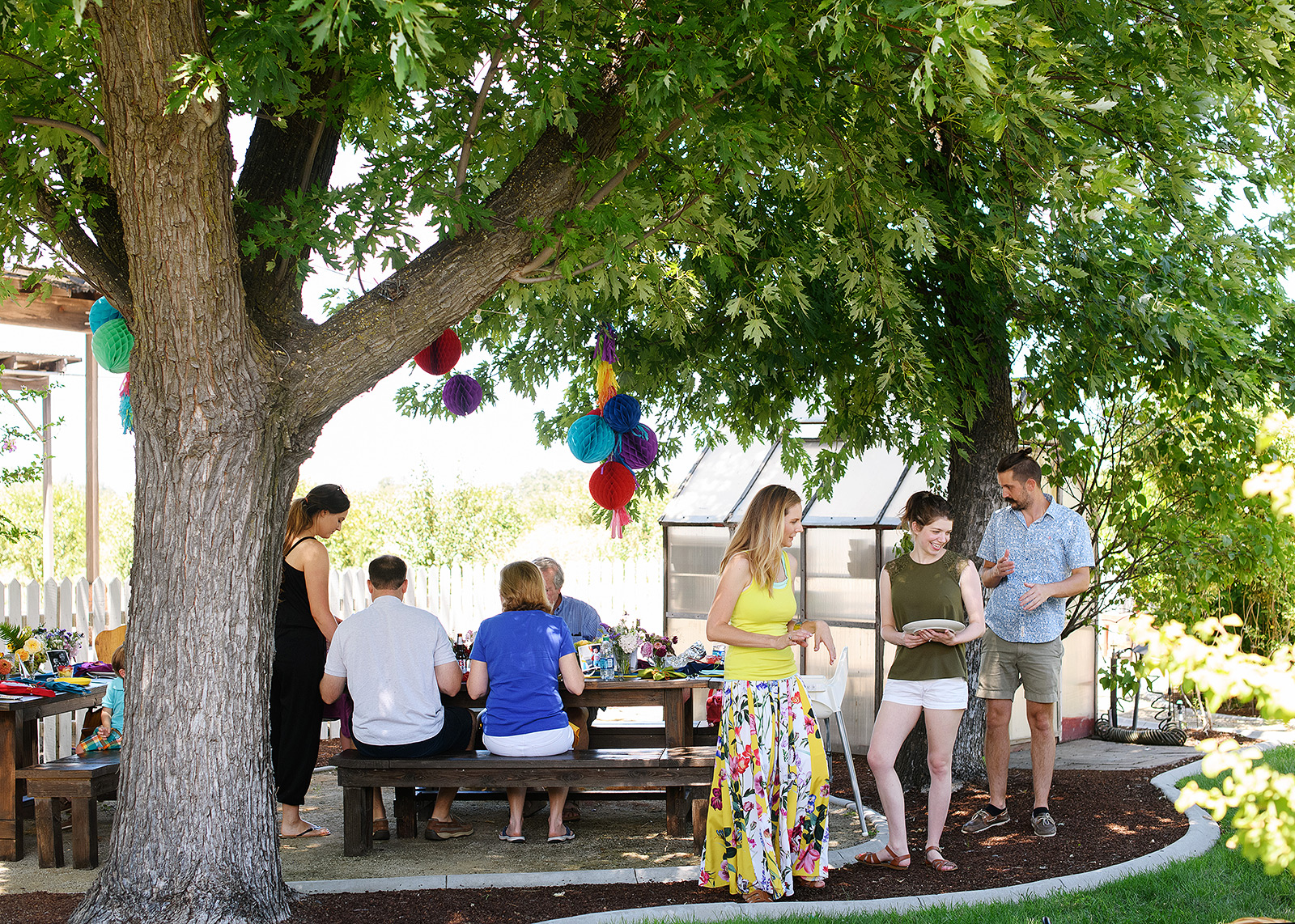 First birthday party outdoors with guests enjoying themselves